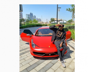 Nigerian Musician Turned Self-Proclaimed Bitcoin Broker Buys A Ferrari
